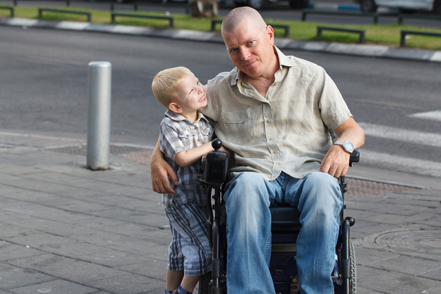 disabled man and son